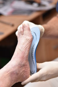 Foot orthotics - photo of a fitting - Foot Dynamics